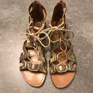 "G by Guess ""Aged Metallic"" Gold Gladiator Sandals"